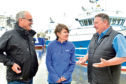 SWFPA policy advisor Kenny Coull, Bernadette Clark of the Marine Conservation Society and Scottish Seafood Association CEA Jimmy Buchan in conversation at Peterhead harbour.