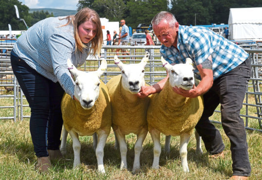 Sarah Finnie and Colin Scott, Balthangie, with the show champion of champions - three Texel cross gimmers.