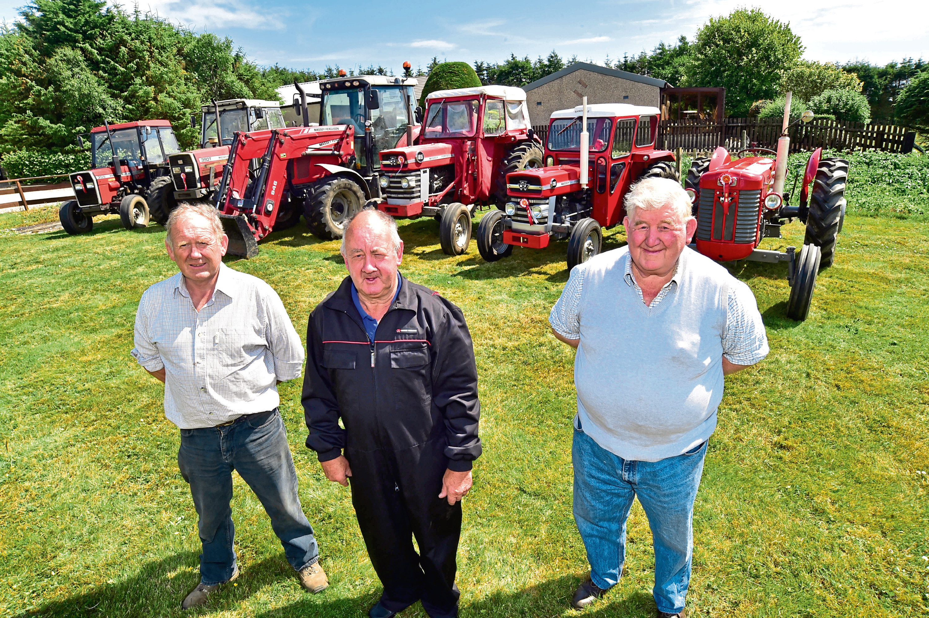 Charlie Cruikshank, Doug Nicol and Bill Stewart with some of the tractors heading to the show.