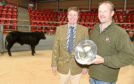 The winning animal from Mark Munro (right) of Invercharron Mains, Ardgay, and Martin Mackay of Brodies LLP, sponsors, on the left.