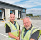 Tony Lewis (left) and Graham Kinghorn photographed outside the new Coop distribution centre at Dalcross, Inverness which is due to open in September,