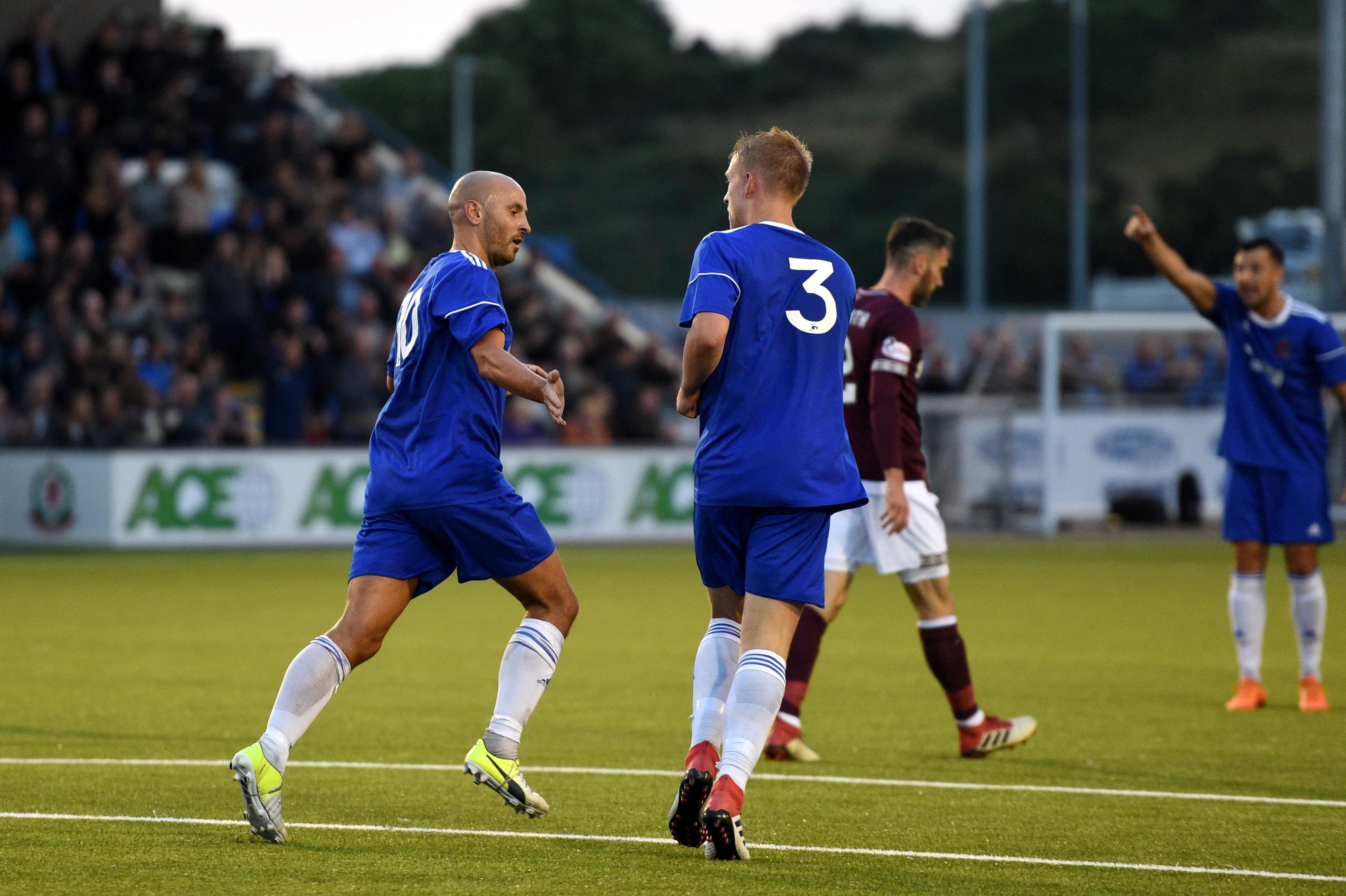 Paul McManus (left) celebrates scoring against Hearts.