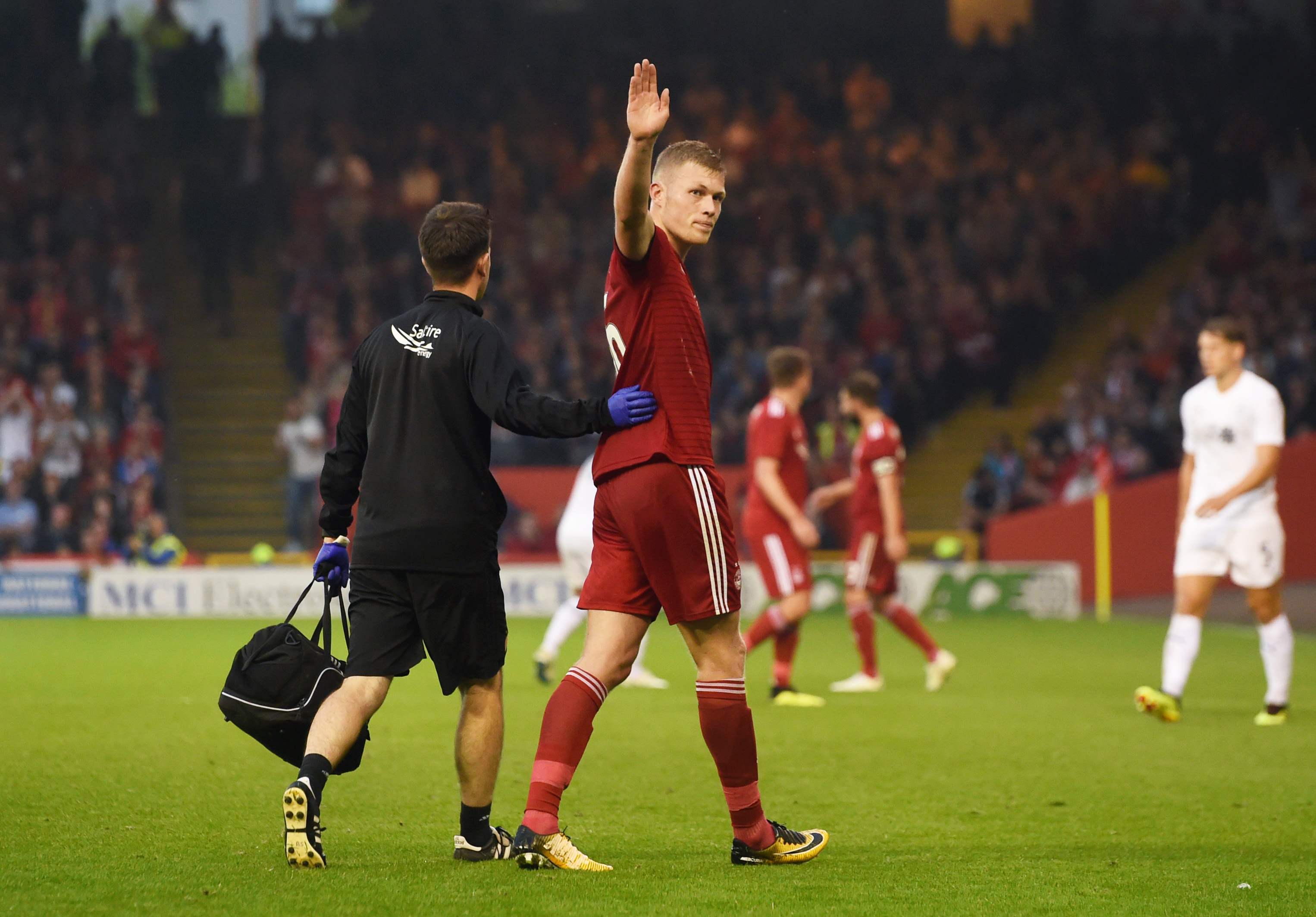 Sam Cosgrove salutes the Aberdeen fans during his impressive performance in the first leg against Burnley.