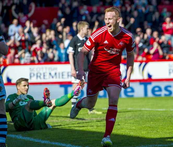 Aberdeen's Adam Rooney celebrates after putting his side 1-0 up against Dundee Utd in April 2015.