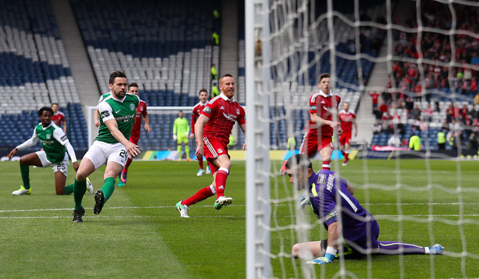Rooney scoring the opener against Hibs in the 2017 Scottish Cup semi-final after only 12 seconds.