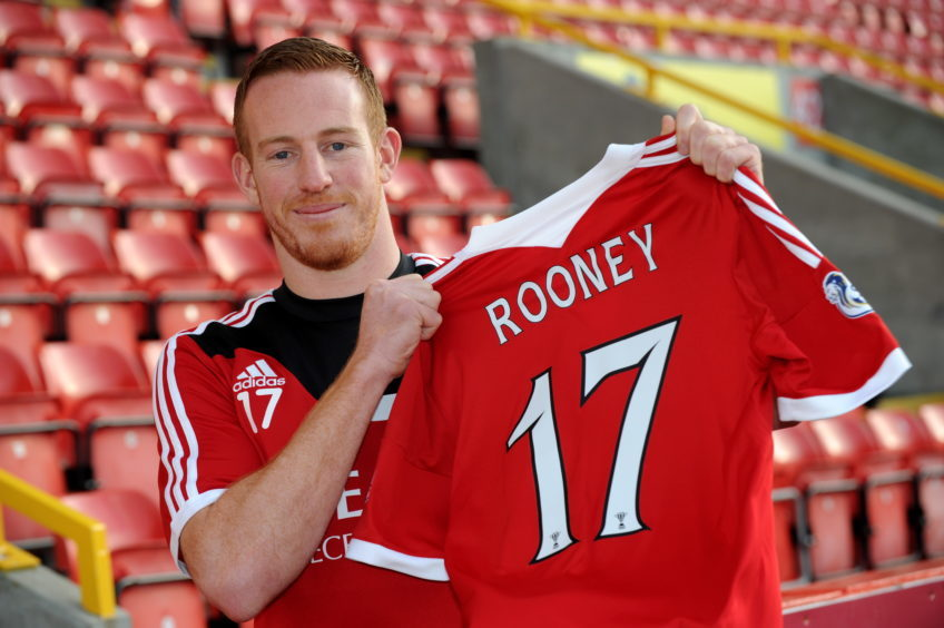 Adam Rooney is paraded as a new signing on January 23, 2014. Picture by Kenny Elrick