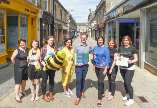 Business owners celebrate Batchen Street's upturn in fortunes. Pictured: Gill Neill, manager of Elgin Bid, Tina Mainland, Elgin Bid, Rachael Horsburgh, staff member at Pencil Me In, Deborah Smethurst, owner of Alluring Boutique, Richard Cumming and Linda Littlewood, both co-owners of Sirology, and Grace Stewart and Louise Grant, staff at LCTG.