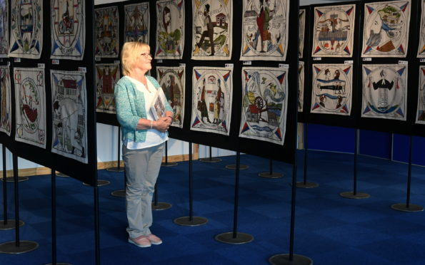 The world famous Diaspora Tapestry is on display at Inveruire Heritage Centre. Pictured is centre volunteer Carol Robertson getting a sneak preview. Picture by Chris Sumner.
