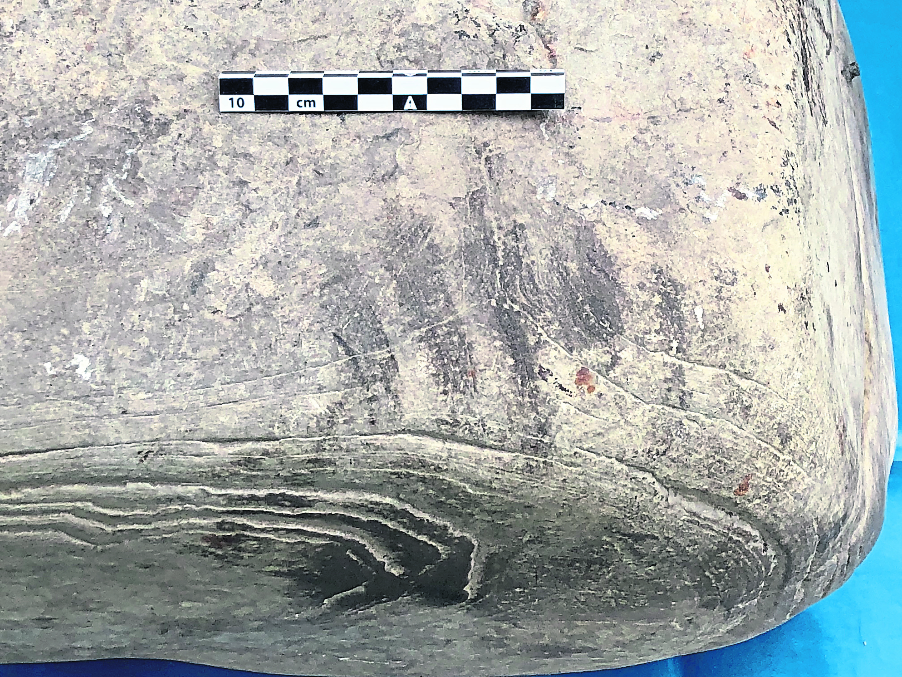 Image of a possible handprint on the stone.