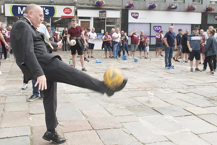 Lord Provost Barney Crockett showed off his keepie-uppie skills to travelling Burnley fans waiting for the Clarets' Europa League clash with Aberdeen.