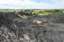 The burned landscape after a gorse fire in Buckpool, Moray next to Buckpool golf course. Picture by Jason Hedges