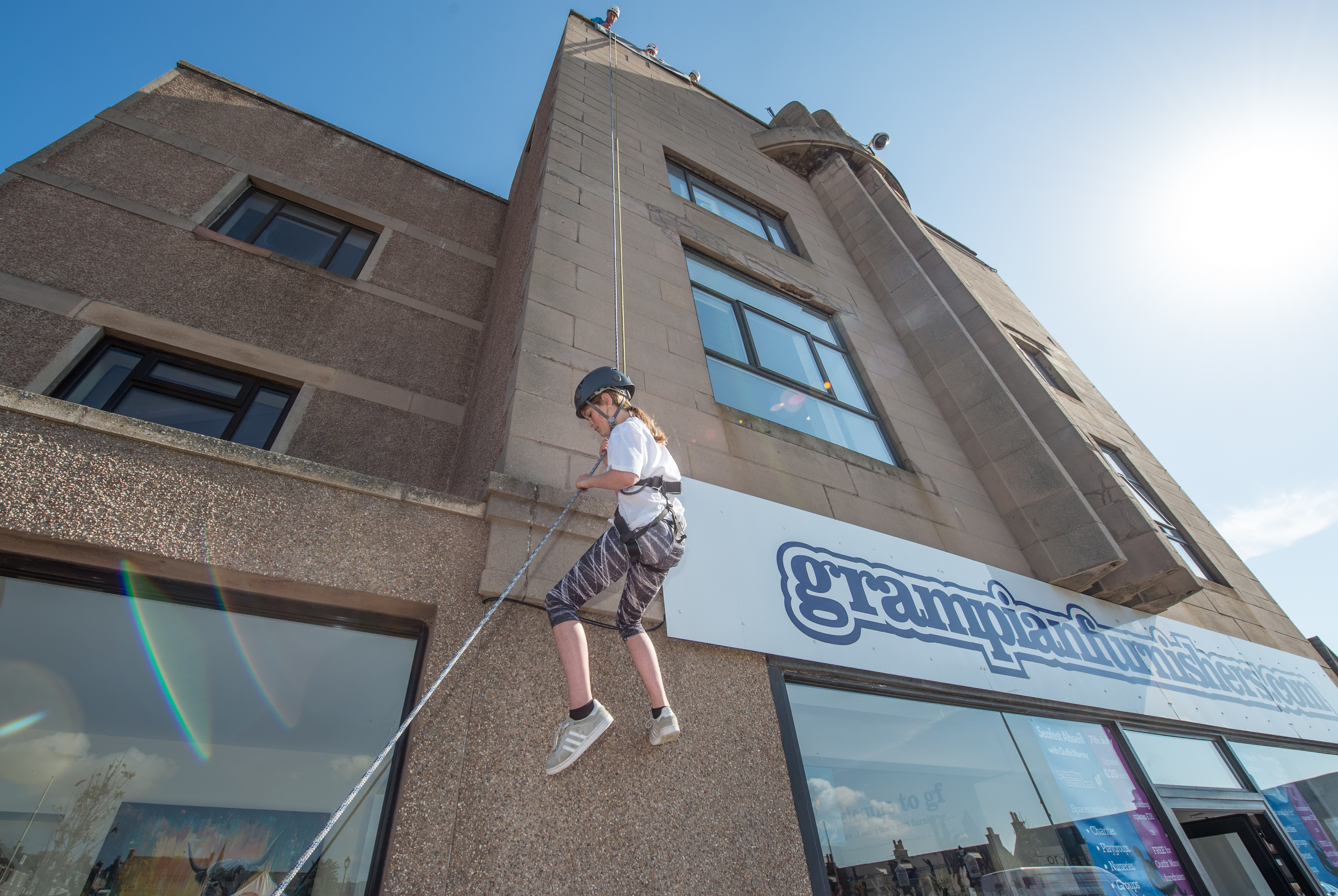 Kacie Dick from Hythe Hill Primary was one of the charity abseilers raising money for Outfit Moray. Picture by Jason Hedges.