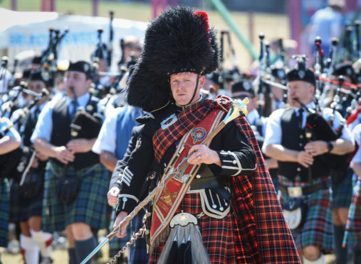 Massed pipe bands at the Forres Highland Games.