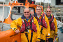 Lifeboat Crew of Laura Moncur - John (Jake) Murray 2nd Coxain, Geddes Wood, Navigator and Radio operator, Kenny Farquhar, Bow man.