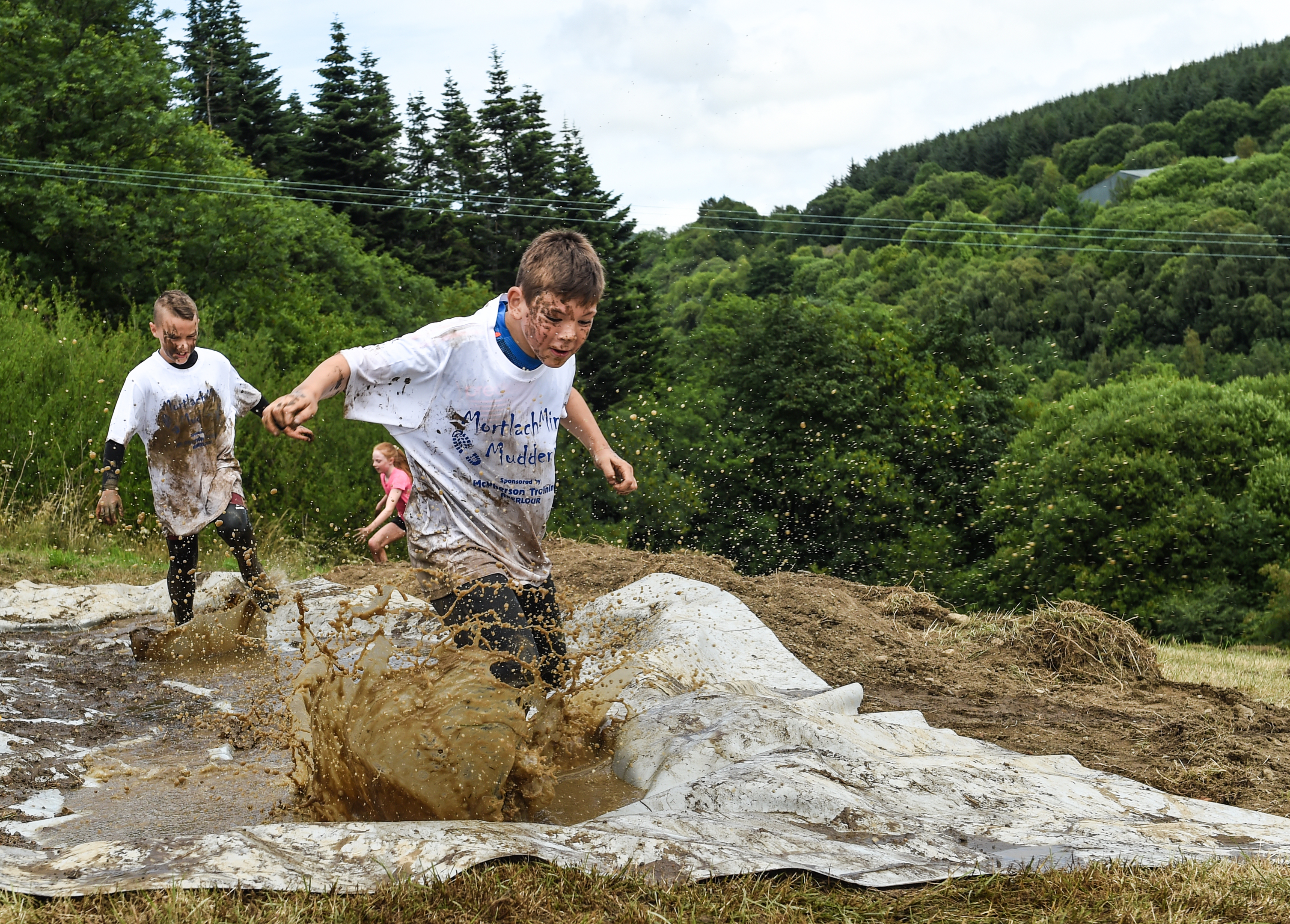 Contestants compete in this years Mortlach Mud Mayhem - 'Mudder' event in Dufftown, Moray. Picture by Jason Hedges.