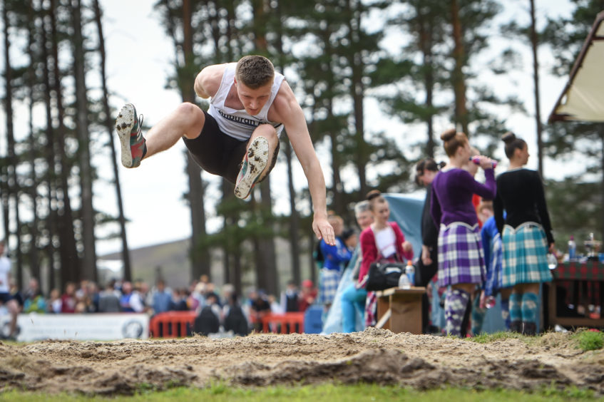 Picture by JASON HEDGES   Pictures show the sporting events of Tomintoul, 2018 Highland Games.  Picture: Findlay Donegal from Elgin long jumping.