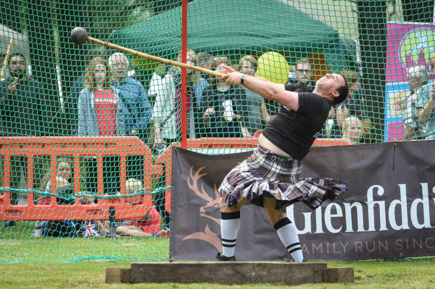 Picture by JASON HEDGES   Pictures show the sporting events of Tomintoul, 2018 Highland Games.  Picture: Kyle Randalls wins The Heavy Hammer.