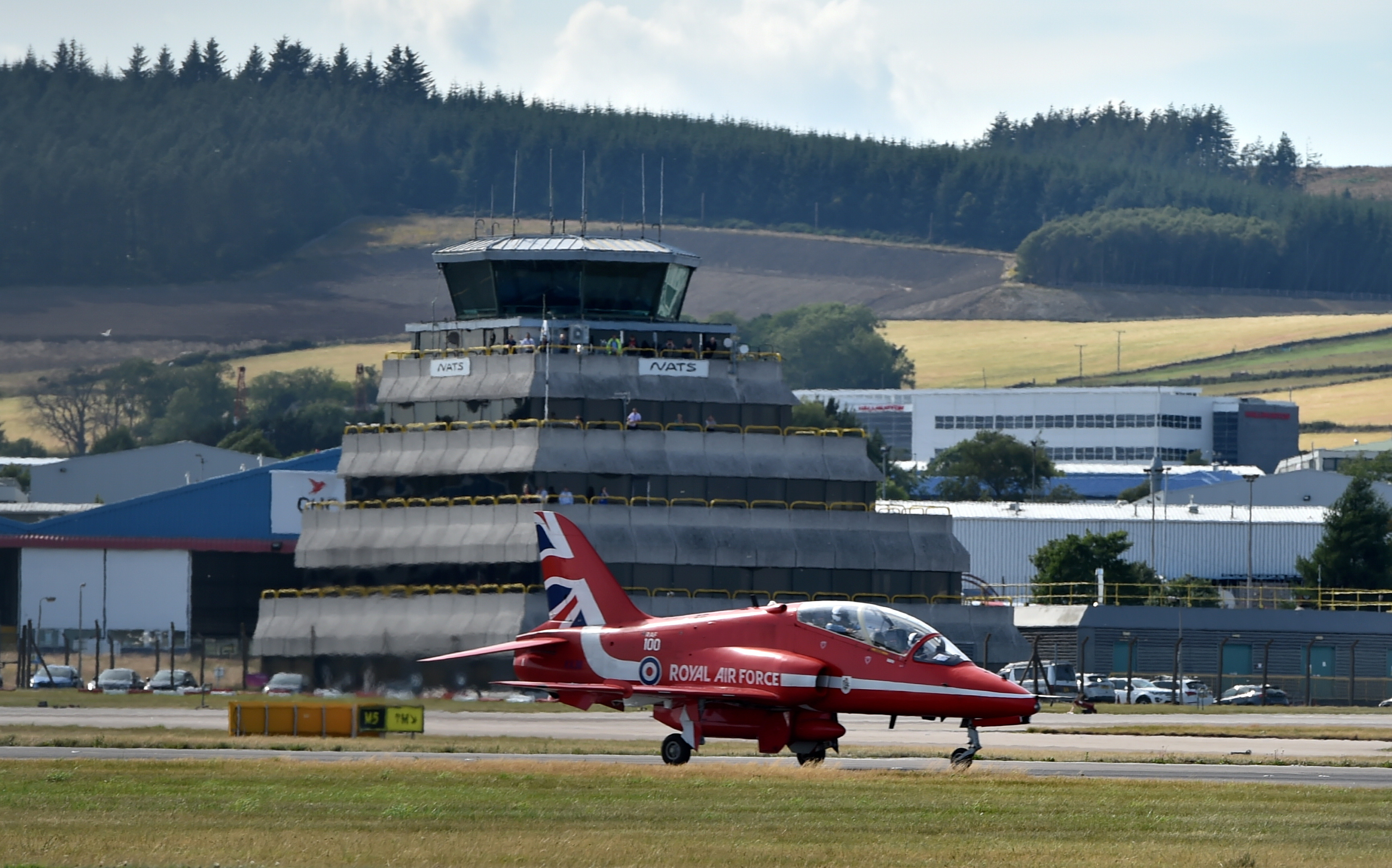 Red Arrows arriving at Aberdeen International Airport.  Picture by KENNY ELRICK     25/07/2018