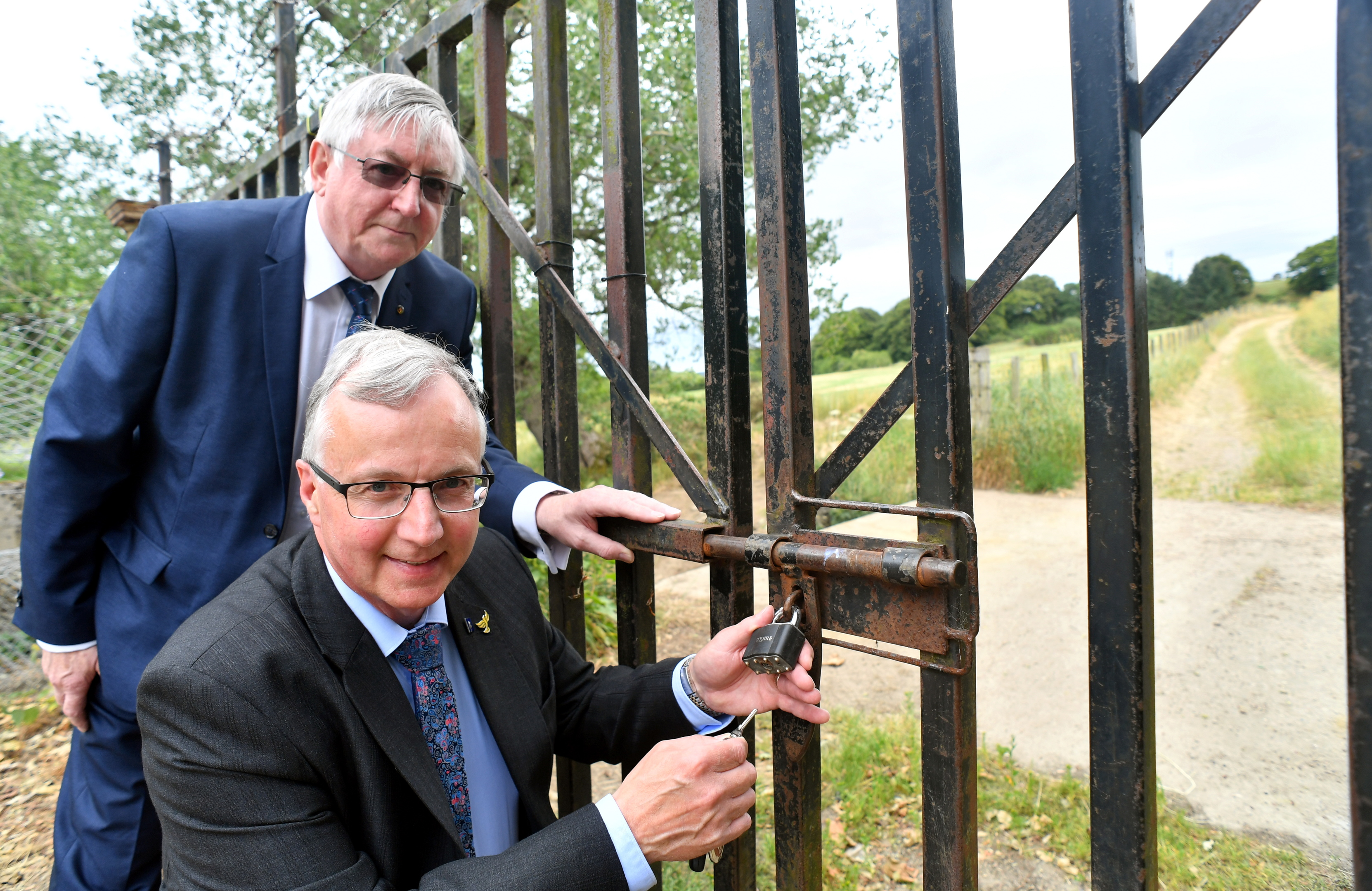 Councillors Dominic Lonchay and Fergus Hood at the entrance gate to the walk over Tuach Hill which will be opened again soon after an asbestos problem was resolved.