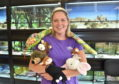 Kate Barrie with some of the cuddly props she uses to teach babies sign language. Picture by Scott Baxter