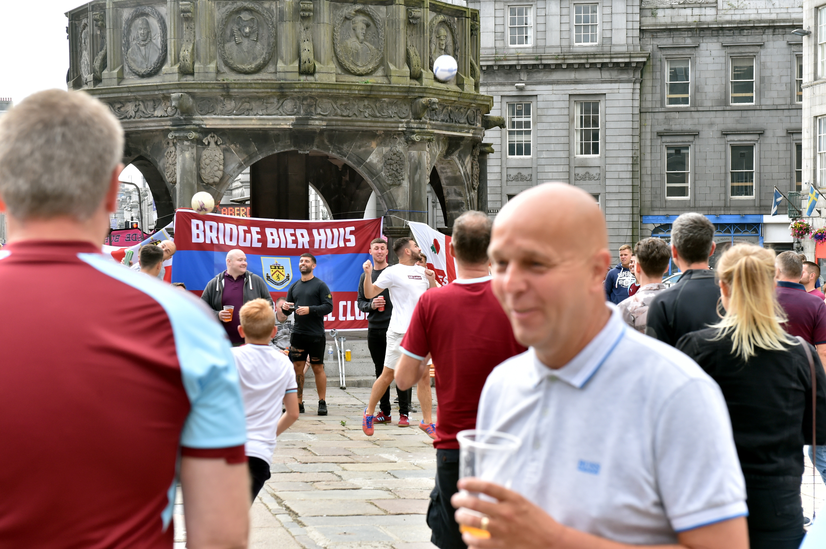 Fans gather before tonights match in Aberdeen's Castlegate.  Picture by Scott Baxter
