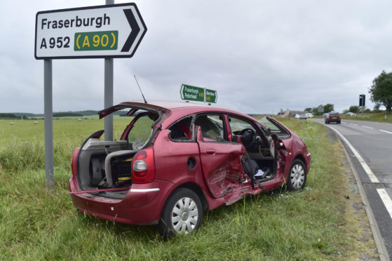 One of the vehicles involved in a two-car crash at the Toll of Birness on the A90 Aberdeen to Peterhead road