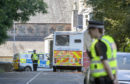 A police cordon on Ardbeg Road on the Isle of Bute in Scotland, after officers found the body of a young girl on the site of the former Cames Hydro Hotel. (Jane Barlow/PA Wire)