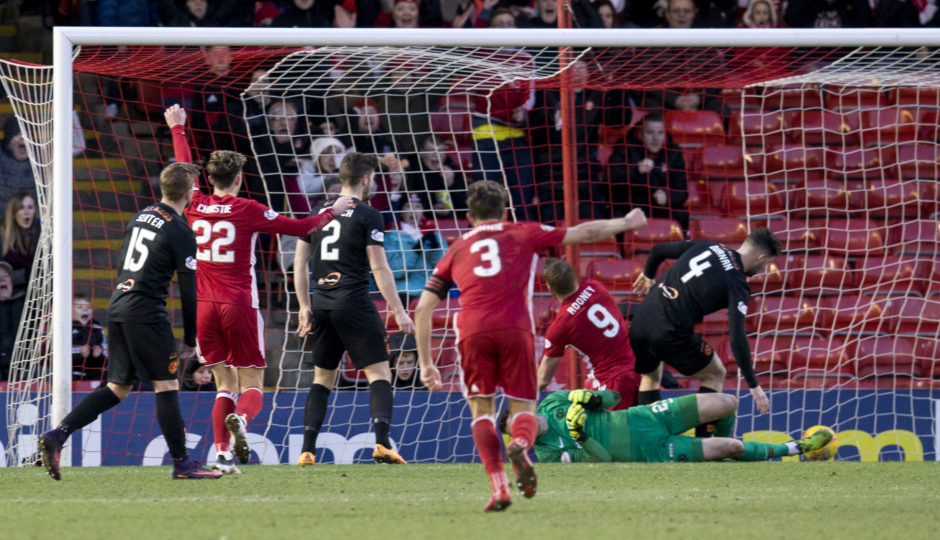Aberdeen's Adam Rooney scores to make it 1-0, his final goal for the Dons against Dundee Utd in February 2018.