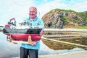 Alex Oldman is pictured with his model radio controlled boat at Tarlair Swimming Pool, Banff, Aberdeenshire. Picture by Jason Hedges