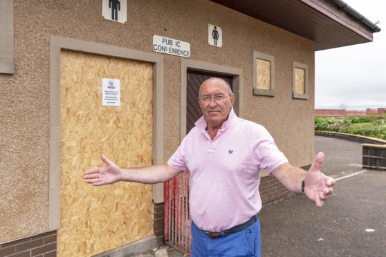 This is the closed public toilets at Station Park Lossiemouth, Moray along with chairman of Lossiemouth Community Council, Mike Mullholland on Wednesday 11 July 2018. Photographed by Brian Smith T/A Jasperimage ©.