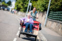 Dr Katie Walter takes Mary Dyce for a ride at the WheelNess to Wellness project, Inverness Launch.