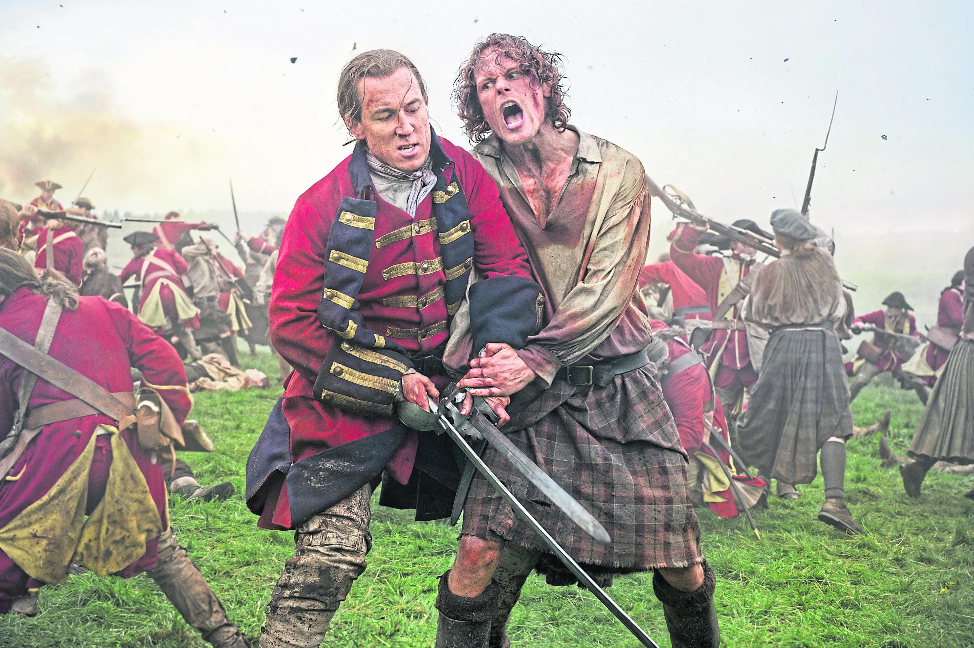 Tobias Menzies as Jack Randall and Sam Heughan as Jamie Fraser in Outlander.