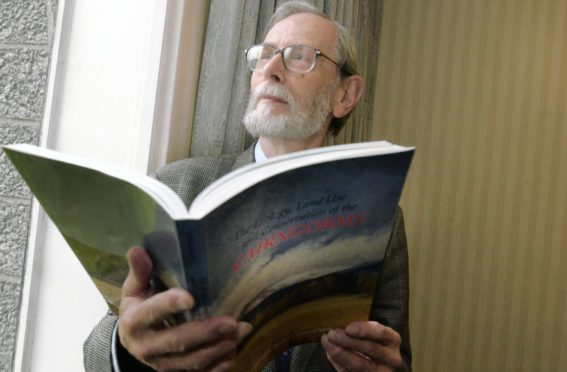 Professor Charles Gimingham with a copy of The Cairngorms, which he edited in 2002.