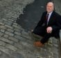 MSP Kevin Stewart at Old Aberdeen High Street where the cobbles were tarred over. Picture by Colin Rennie.