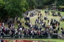 Robert Gordon university graduates at HMT, Aberdeen. In the picture graduates and families congregate in the Union Terrace gardens.   Picture by Jim Irvine  10-7-18