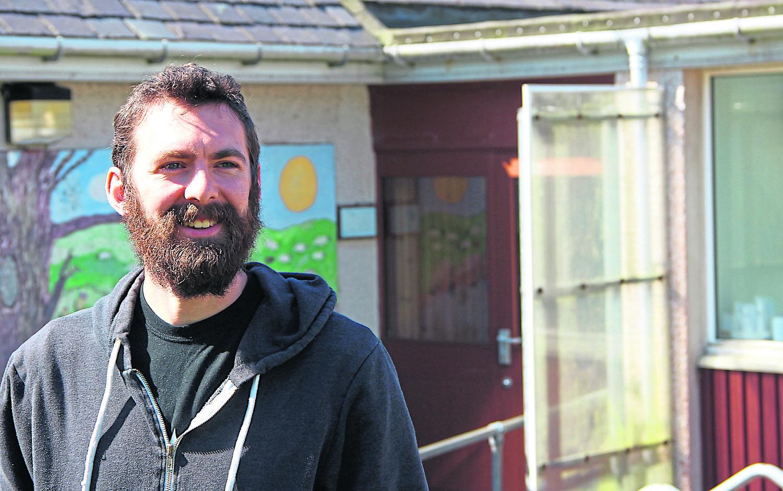Alistair Morgan outside the Voe school premises.