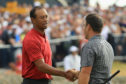Francesco Molinari is congratulated by Tiger Woods after the final round of the 147th Open at Carnoustie.