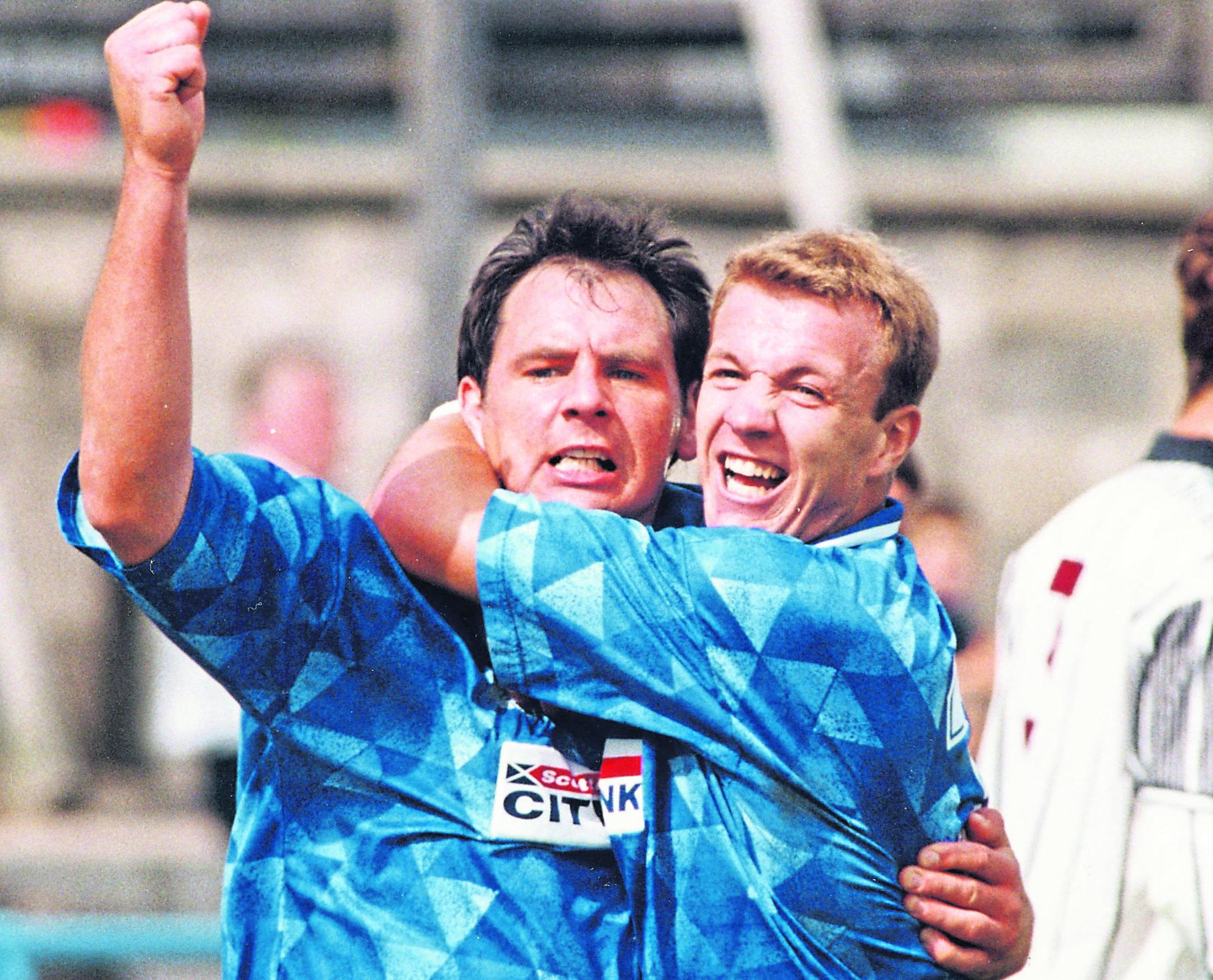 Inverness CT's Alan Hercher (left) celebrates his goal with defender Mark McAllister.