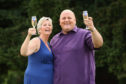 Gillian Bayford celebrating winning the jackpot in 2012 with then-husband Adrian.