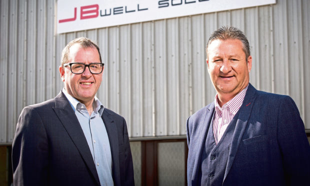 Local businessmen Robbie Garden, left, and Robbie Gray outside the JB Well Solutions headquarters