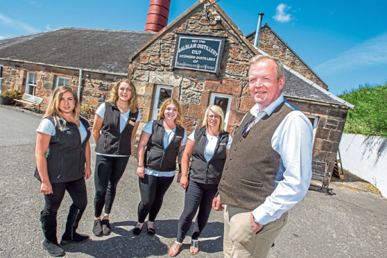 John MacDonald, manager at Balblair, with staff at the popular at the popular distillery
