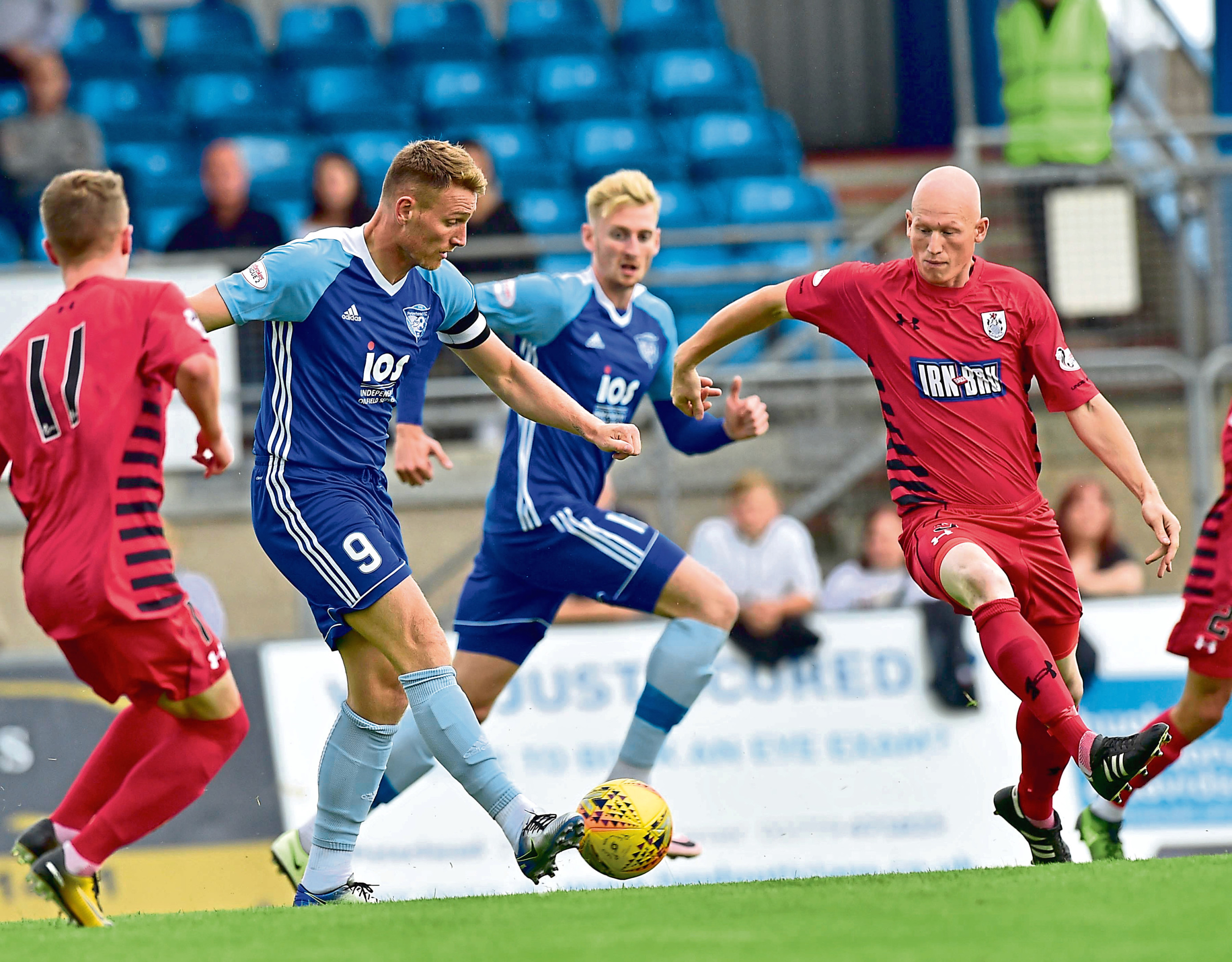 Peterhead goal hero Rory McAllister, second from left, fires a shot at the Queen's Park goal