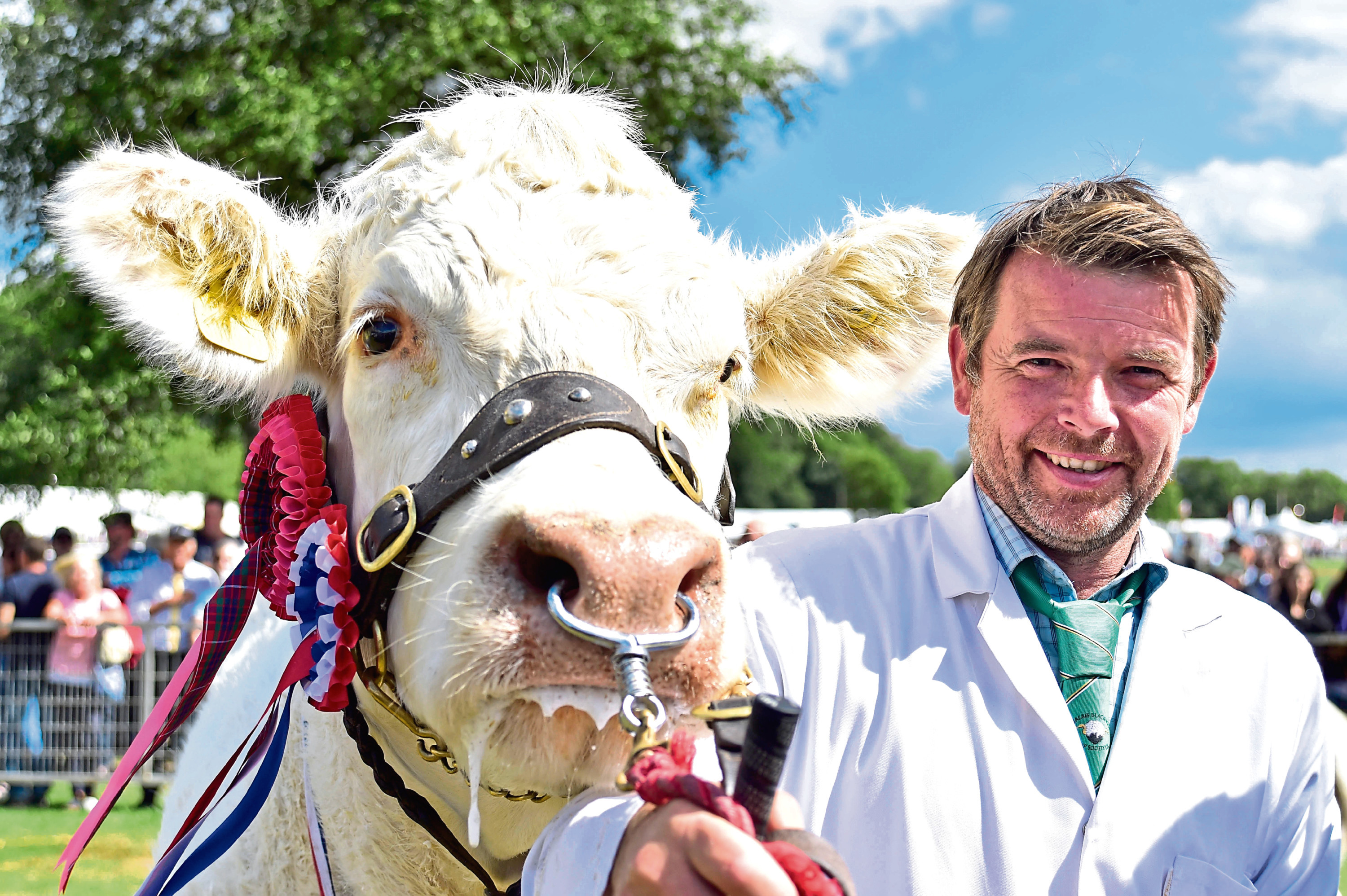 Raymond Irvine with his Charolais cow which stood show champion of champions.