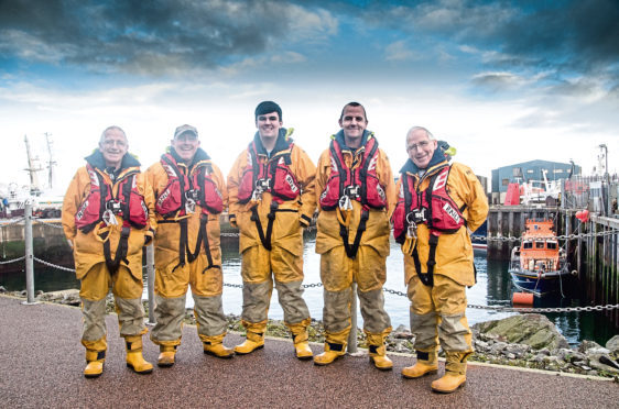 Victor Sutherland (senior), Vic Sutherland (son), Declan Sutherland (grandson, Dave's son), Dave Sutherland (son) and Albert Sutherland (twin brother) in Fraserburgh Harbour.