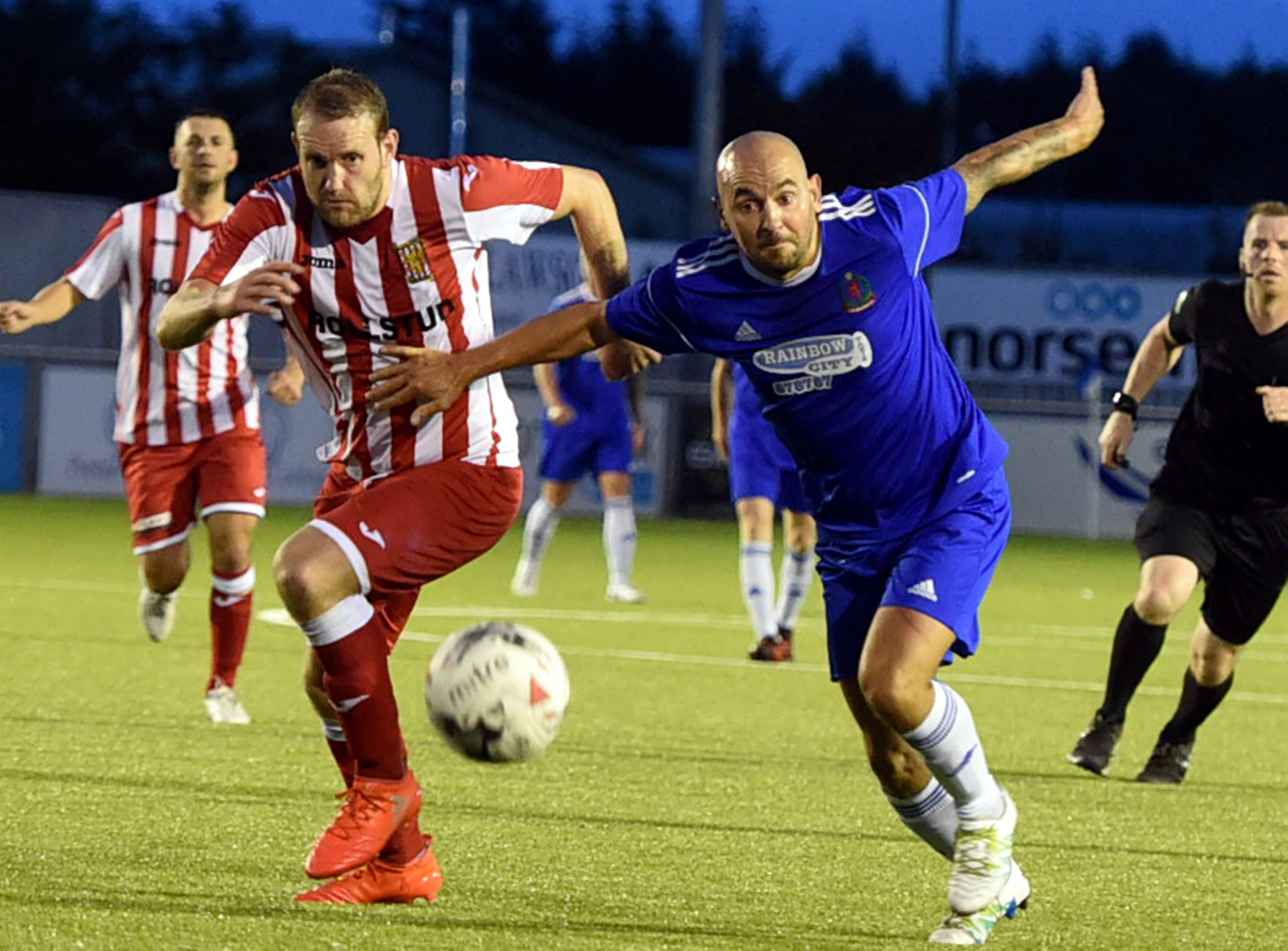 Garry Wood and Paul McManus tussle during the Cove Rangers v Formartine United tie.
