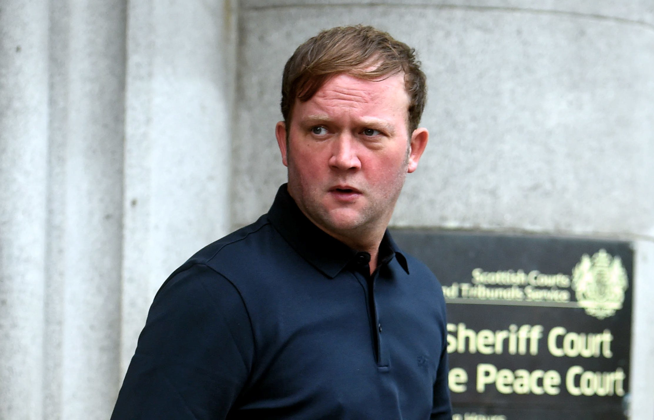 Andrew Simpson walking out of Aberdeen Sheriff Court.