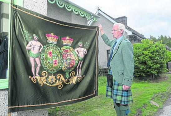 The Duff Highlanders banner, held by David Geddes.
