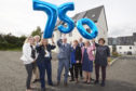 Housing minister Kevin Stewart MSP celebrates with local councillors in Inverness at the 750th build