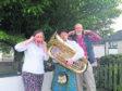 Julia de Meillon, Edward Hatton playing tuba, and Niall Ramsay.