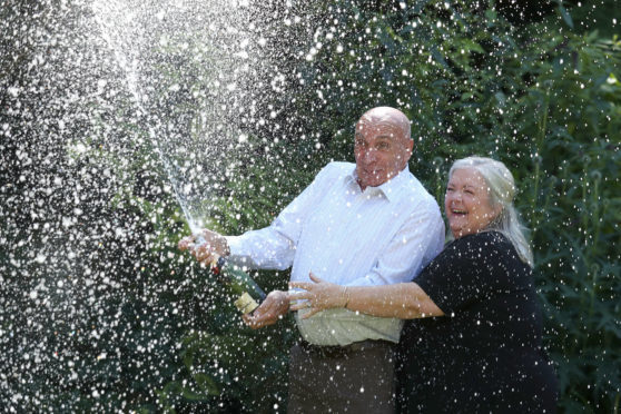 Fred and Lesley Higgins from Laurencekirk celebrate their £58m EuroMillions lottery win.